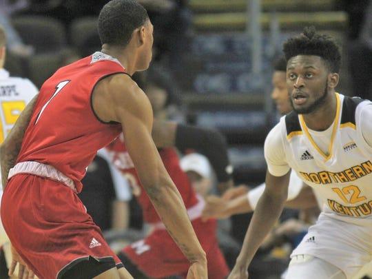 NKU freshman Trevon Faulkner keeps an eye on Miami