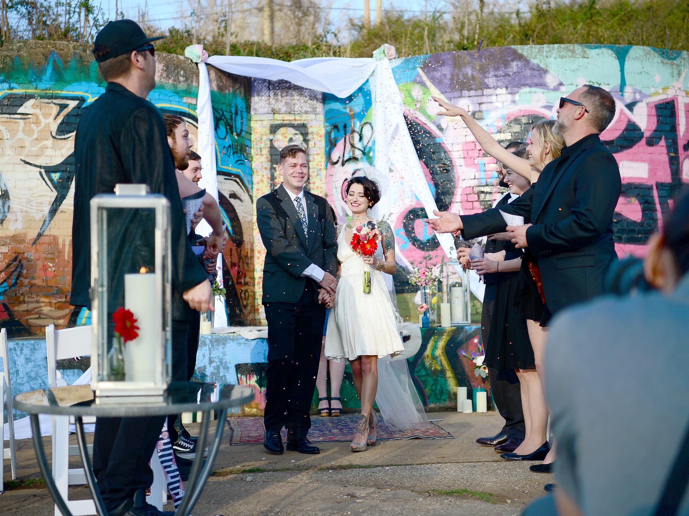 "Mike Rice takes a photograph of ""bride"" Sam Antaramian"