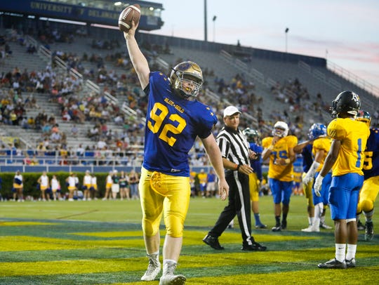 Kyle Cathers celebrates his 1-yard touchdown run in the 2016 DFRC Blue-Gold All-Star game at Delaware Stadium.