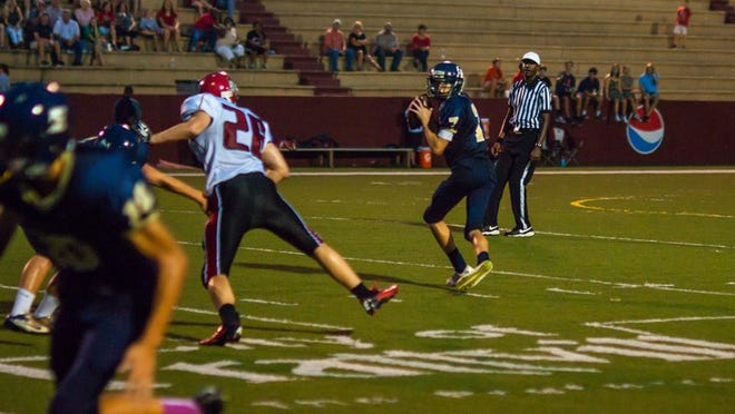 East Memorial quarterback Sam Harris has completed 94 of 202 passes for 2,374 yards, 31 TDs and seven interceptions this season.