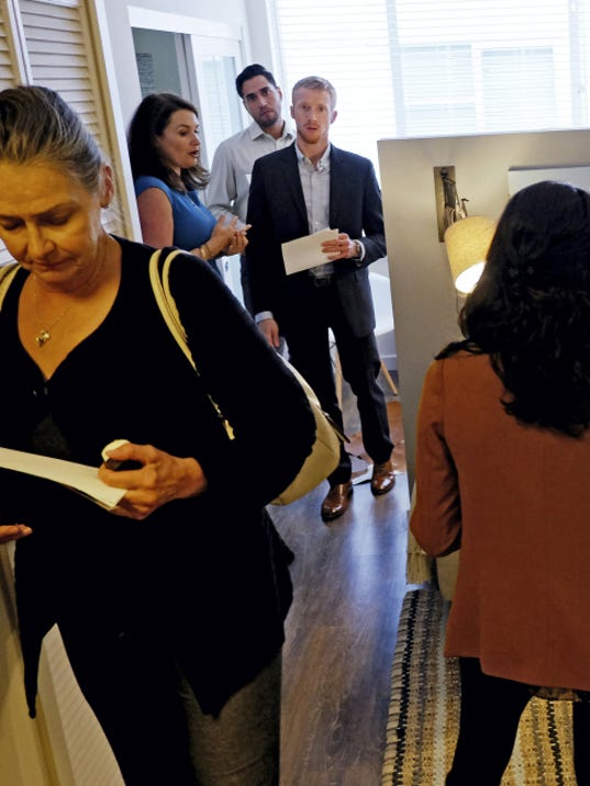 Visitors tour an apartment at the Gibson Santa Mon- ica, a new luxury apart-ment building in downtown Santa Monica, California.