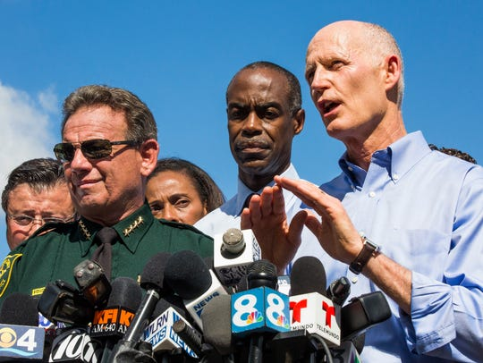 Gov. Rick Scott, alongside Broward CountyÊSuperintendentÊRobert