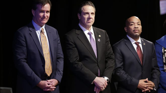 Gov. Andrew Cuomo has been pressuring the Legislature to hold a special session before its current term ends at the start of January. Gov. Andrew Cuomo, center, stands with Senate Majority Leader John Flanagan, left, R-Smithtown, and Assembly Speaker Carl Heastie, D-Bronx, before delivering his State of the State address and executive budget proposal in January.