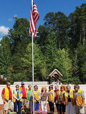 In May 2018, Hot Springs Village Breakfast Lions (from left) John Pritchard, Sami Jo Magoffin, Mark Winburn, Joanie Corry, Tina Taylor, Jane Berault, Patty Smith, Dottie Stewart, Jan Peterson, Helen Van Stone, and Bob Peterson, celebrated a new flag at Boys and Girls Clubs of Saline County's Great Futures Daycare facility.
