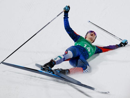 Jessica Diggins, of the United States, celebrates after winning the gold medal in the during women's team sprint freestyle cross-country skiing final at the 2018 Winter Olympics in Pyeongchang, South Korea, Wednesday, Feb. 21, 2018. (AP Photo/Kirsty Wigglesworth)