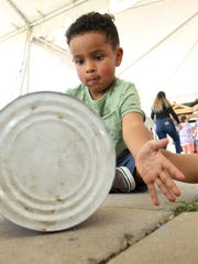 Nolan Elix, 4, of Las Cruces, makes his own tin can