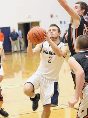 Woodmore's DJ Wellons puts up a shot against Otsego.