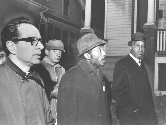Comedian Dick Gregory (center, with Father James E. Groppi at left) brought his activism to Milwaukee numerous times, and led several fair-housing march in Milwaukee, like this one on Dec. 17, 1967.