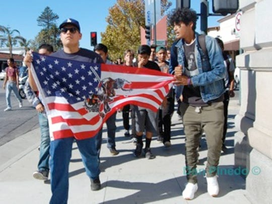 Pacifica High School students protested the election of Donald Trump last week as president during a rally through downtown Oxnard.