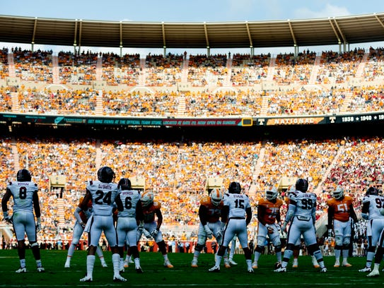 Shadows fall on players during the Tennessee Volunteers