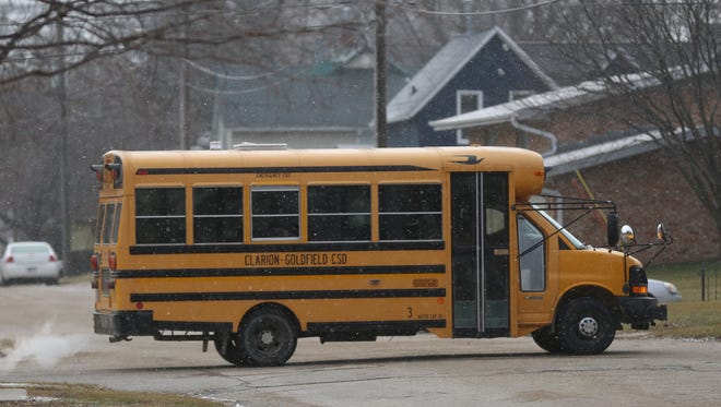 A school bus passes down the road near Clarion-Goldfield Middle School on Tuesday, Dec. 16, 2014 in Clarion, Iowa.