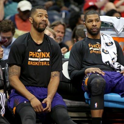 Suns forward Markieff Morris (left) and forward Marcus