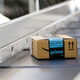 An Amazon package traveling on a conveyor belt in a fulfillment center.