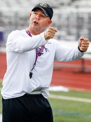 Christian Brothers High School head coach Thomas McDaniel runs his team through drills during the first day of fall camp.