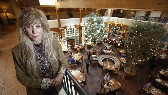 In this photo taken, Friday, June 17, 2016, Gale Cooper, from Sandia Park, poses for a portrait at La Fonda in Santa Fe, N.M. Cooper, who closed her Beverly Hills psychiatry practice in the late 1990s, moved to New Mexico to write a novel based on the life of Billy the Kid. She is now fighting a legal battle over the state's public records law.