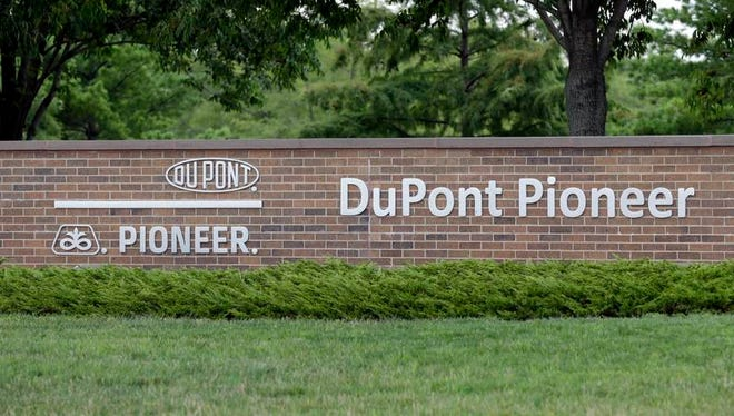A DuPont Pioneer sign is seen outside the companies' headquarters in Johnston, Iowa.