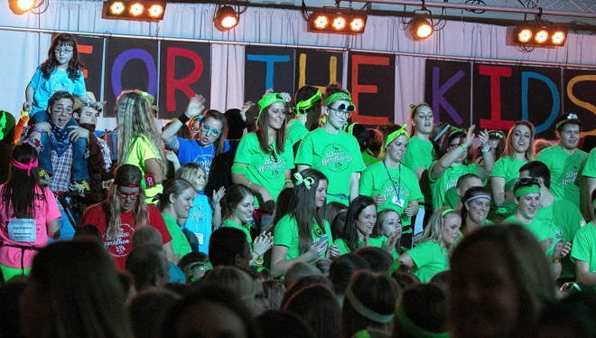 Students and kids dance during the 2014 Iowa Dance Marathon at the Iowa Memorial Union. The University of Iowa students will continuously dance for 24 hours to raise funds and awareness for the Iowa Children's Hospital.