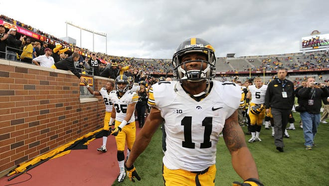 Iowa's Kevonte Martin-Manley and the Hawkeyes celebrate after a 23-7 win over Minnesota on Saturday, Sept. 28, 2013, at TCF Bank Stadium in Minneapolis.
