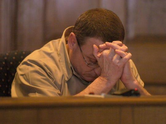 Former Fairfield County Sheriff Gary DeMastry lowers his head during a hearing on his early release from prison in 2007.