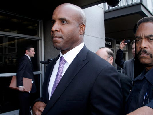 FILE - In this April 13, 2011, file photo, former baseball player Barry Bonds leaves federal court in San Francisco, after being found guilty of one count of obstruction of justice. Bonds' obstruction of justice conviction was thrown out Wednesday, April 22, 2015, by a federal court of appeals, which ruled 10-1 that his meandering answer before a grand jury in 2003 was not material to the government's investigation into illegal steroids distribution. (AP Photo/George Nikitin, File)