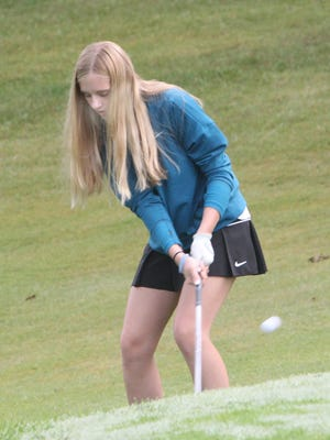 Freshman Vallie Schermerhorn of Westran High School watches where her chip shot placed toward the sixth hole ends up while participating in the 2020 Westran Girls Golf Invitational held Tuesday at Moberly's Heritage Hills Golf Course. Schermerhorn turned in her team's lowest score in this 18-hole event, a 121, on the par-70 course.
