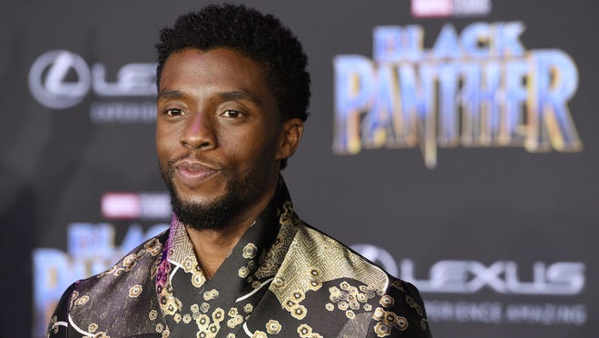 """FILE - In this Jan. 29, 2018 file photo, Chadwick Boseman, a cast member in """"Black Panther,"""" poses at the premiere of the film in Los Angeles. Actor Chadwick Boseman, who played Black icons Jackie Robinson and James Brown before finding fame as the regal Black Panther in the Marvel cinematic universe, has died of cancer. His representative says Boseman died Friday, Aug. 28, 2020 in Los Angeles after a four-year battle with colon cancer. He was 43."""