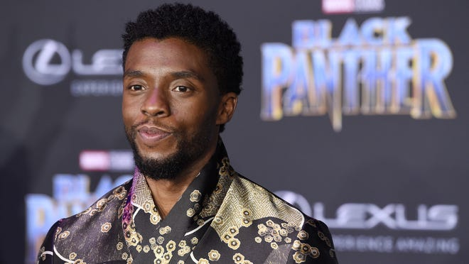 """FILE - Chadwick Boseman, a cast member in """"Black Panther,"""" poses at the premiere of the film at The Dolby Theatre on Monday, Jan. 29, 2018, in Los Angeles."""