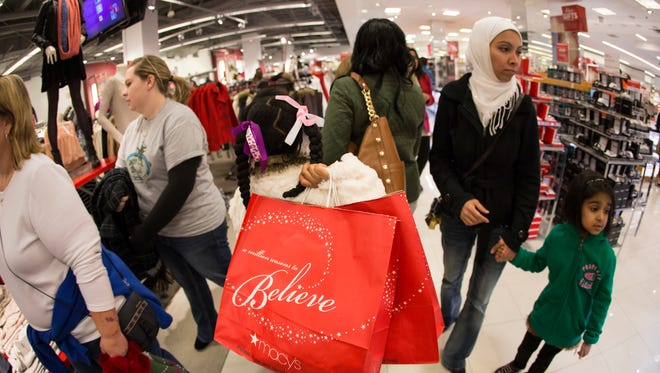 This Nov. 28, 2013 photo released by Macy's shows shoppers at the Macy's Lenox Black Friday store opening in Atlanta. In the pre-dawn hours Friday, as some early-rising shoppers were heading into malls in search of Black Friday deals, others had been up shopping all night in stores that opened the evening of Thanksgiving or at 12:01 a.m. Friday.