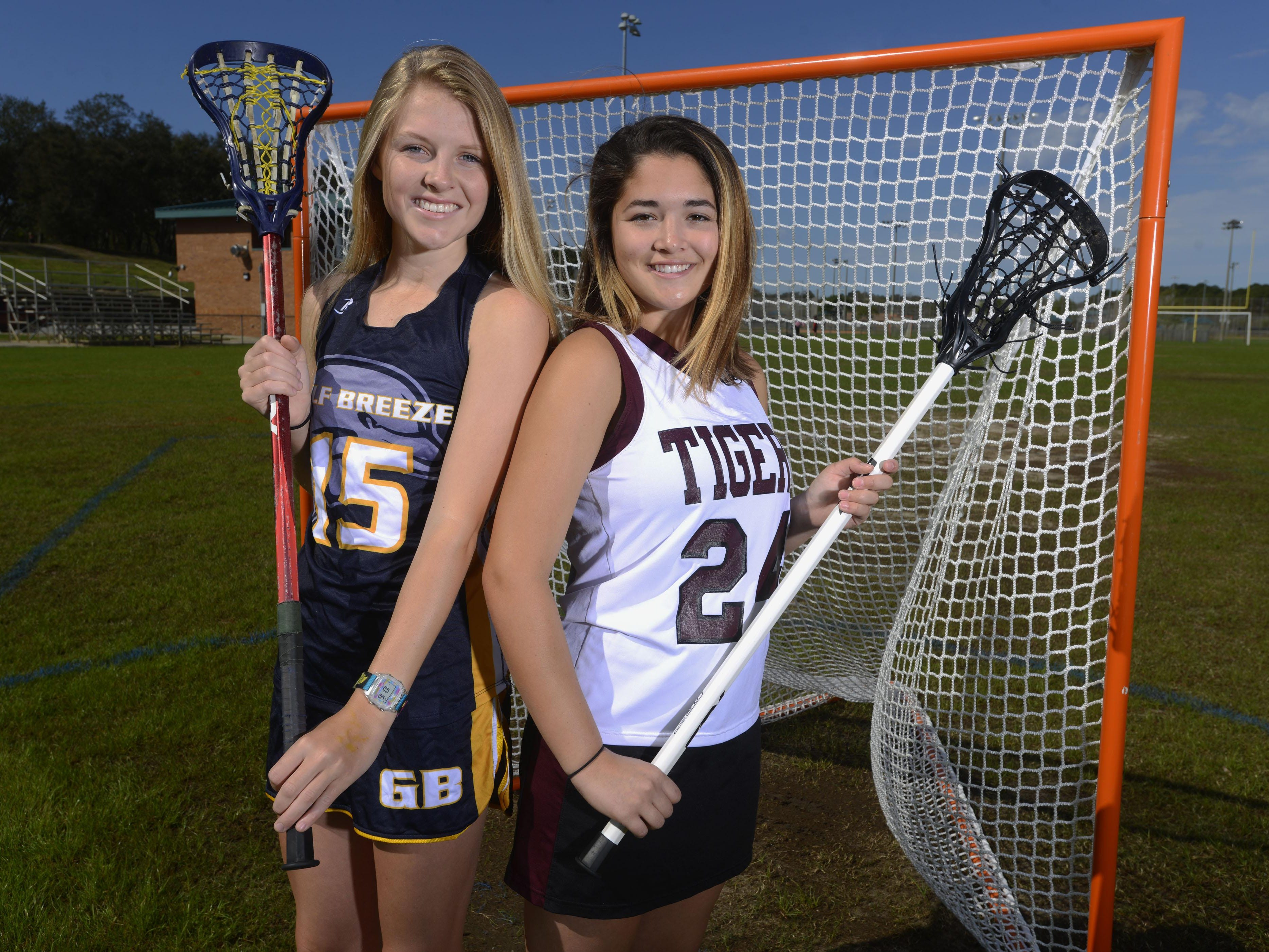 Prep lacrosse stars and best friends Frances Williams, a senior at Gulf Breeze High and Victoria Warren, a junior at Pensacola High, on the field at Shoreline Park where both girls learned the sport as middle school kids.
