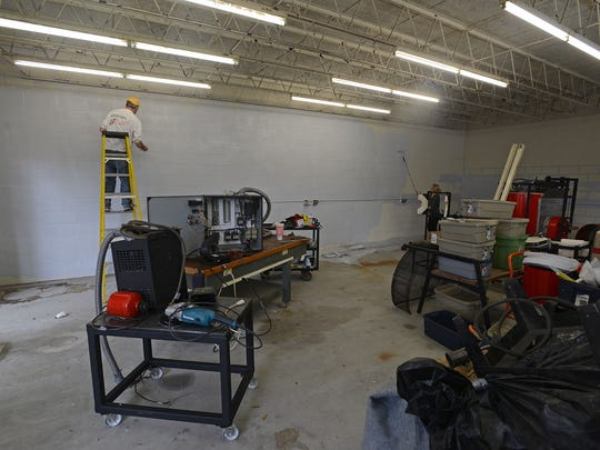 Ryan Novota, brother of Scott Novota, helps Molli and Scott Novota to rebuild their glassblowing studio Strong Street Studio in their new location on A St. after the roof of their old location caved in.