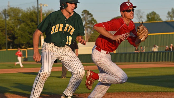 Captain Shreve's Logan Ellinwood scores from third on a wild throw in their first-round LHSAA Class 5A state playoff baseball game Monday against Ruston.