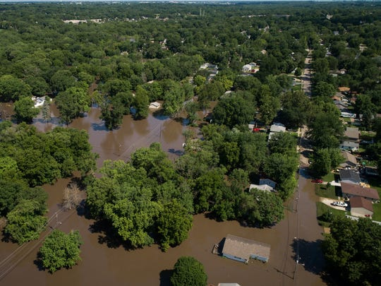 Flood waters spill over Fourmile Creek on July 1, 2018 after flash flooding in Des Moines.