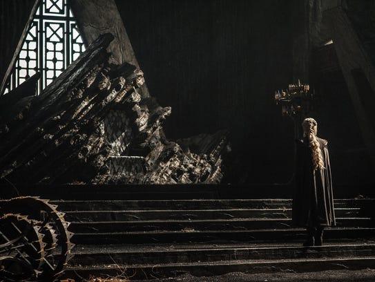 Daenerys Targaryen (Emilia Clarke) examines the ransacked