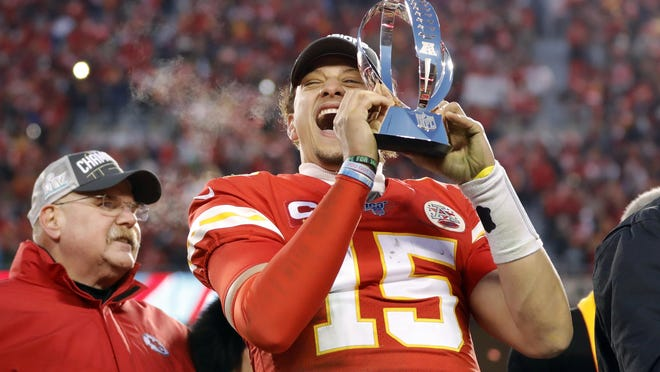 Kansas City Chiefs quarterback Patrick Mahomes holds the Lamar Hunt Trophy as he celebrates winning the AFC Championship game against the Tennessee Titans on Jan. 19 in Kansas City.
