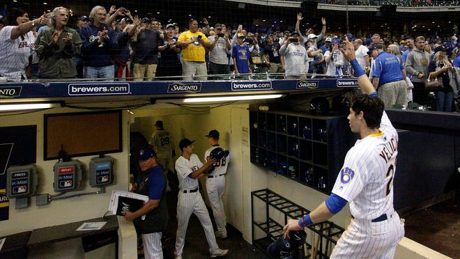 "In this Sept. 7, 2019, file photo, fans cheer as Milwaukee Brewers' Christian Yelich walks off the field after driving in the winning run with a double during the ninth inning of the team's baseball game against the Chicago Cubs in Milwaukee. Major League Baseball will start each extra inning this season by putting a runner on second base. This rule has been used since 2018 in the minor leagues, where it created more action and settled games sooner. ""I think it's great,†Yelich said. ""As a player, there's nothing worse than extra innings."""