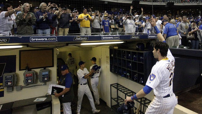 Fans cheer as Milwaukee Brewers' Christian Yelich walks off the field after hitting a game-winning RBI-double during the ninth inning of a baseball game against the Chicago Cubs Saturday, Sept. 7, 2019, in Milwaukee. The Brewers won 3-2.
