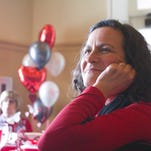 "Brighton resident Francine Michalek listens to a presentation entitled ""Livingston County Goes Red for Women,"" hosted by The Greater Brighton Area Chamber of Commerce, Professional Women's Club of Michigan and Saint Joseph Mercy Health System held at Oak Pointe Golf Club."