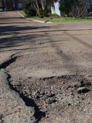 Pothole on Jackson, Miss., street