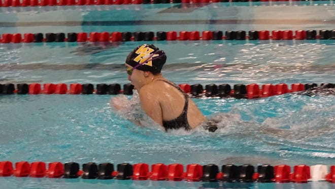 Watkins Memorial exchange student Guada Santos competes in the 100 breaststroke on Jan. 2 during a meet at Denison's Trumbull Aquatic Center.
