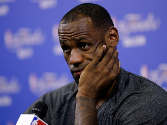 Miami Heat's LeBron James listens to a question during an NBA basketball media availability at the NBA Finals, Wednesday, June 11, 2014, in Miami. The San Antonio Spurs lead the Heat 2-1 in the best-of-seven games series. (AP Photo/Lynne Sladky)