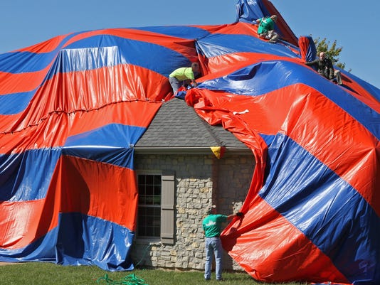 St. Charles house is covered to eliminate spiders