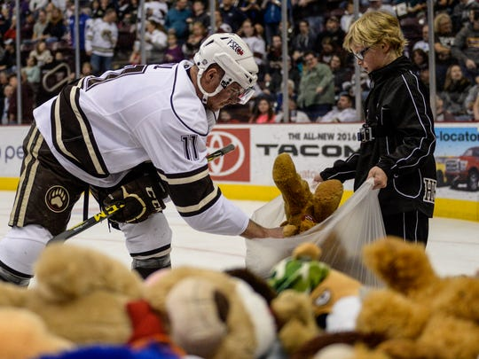 Hershey Bears' Zach Sill helps pick up teddy bears