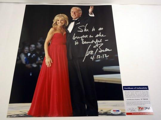 Joe Biden autographed photo with Jill Biden.