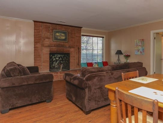 The wood-burning fireplace in the family room has been