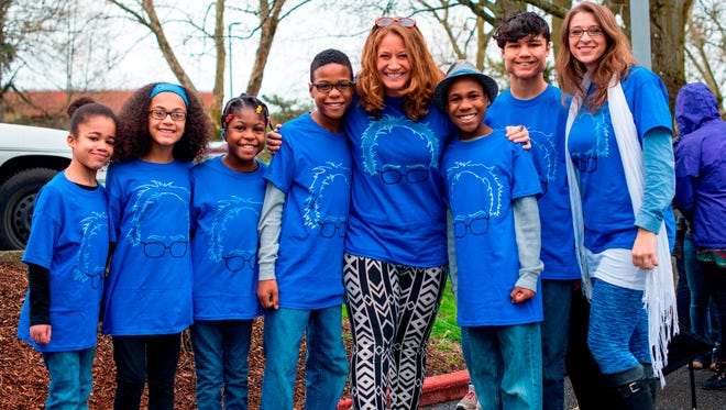 This March 20, 2016, file photo shows Hart family of Woodland, Wash., at a Bernie Sanders rally in Vancouver, Wash.