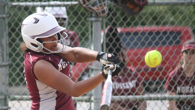 Western Hills' Sonja Rembert makes contacts in game against Mercy on May 8.