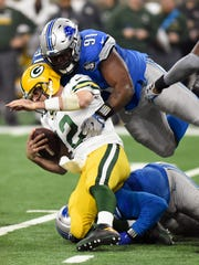A'Shawn Robinson takes down Aaron Rodgers during the second half Jan. 1, 2017 at Ford Field.