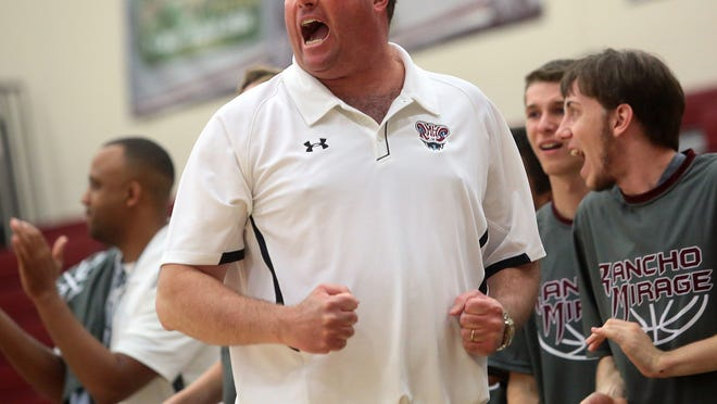 Rancho Mirage High School coach Rob Hanmer pumps his fists and yells in excitement on Wednesday, February 18, 2015 as his team extends their lead during the second half of the Rattlers' boys basketball playoff game against the Banning Broncos. The game marks the first boys basketball playoff game in school history. Rancho Mirage won, 81-56, and advance to the next round of post season play.