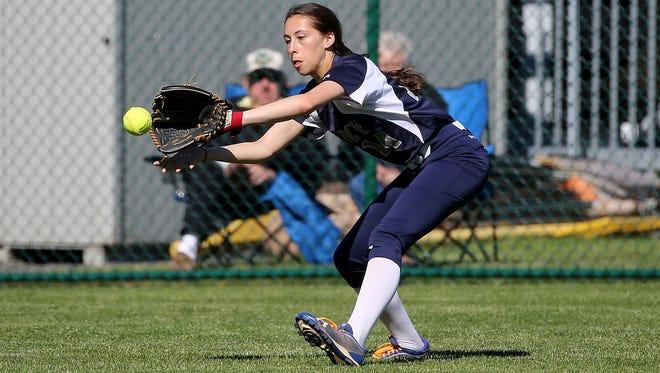 Mercy left fielder Danielle Salina fields a base hit by Williamsville East's Brianna Bucello.