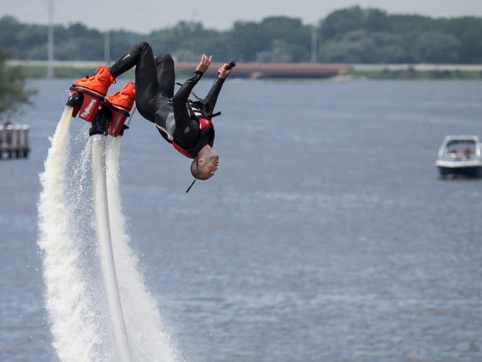 Troy Stowe, a resident of Oshkosh, demonstrates his skill with FlyBoard equipment propelled remotely from a water craft during a Boat Wars show held at Fratello's Restaurant June 28, 2014.
